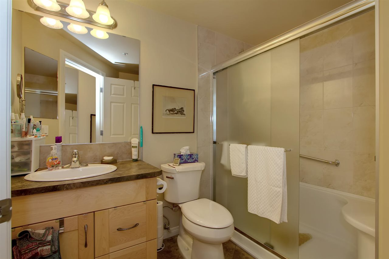 SPLASH removed the tub in this bathroom and replaced it with a more functional walk in double shower complete with seat. The toilet is also new and the popular comfort height. The tub surround is now ceramic tile and extends to the ceiling.