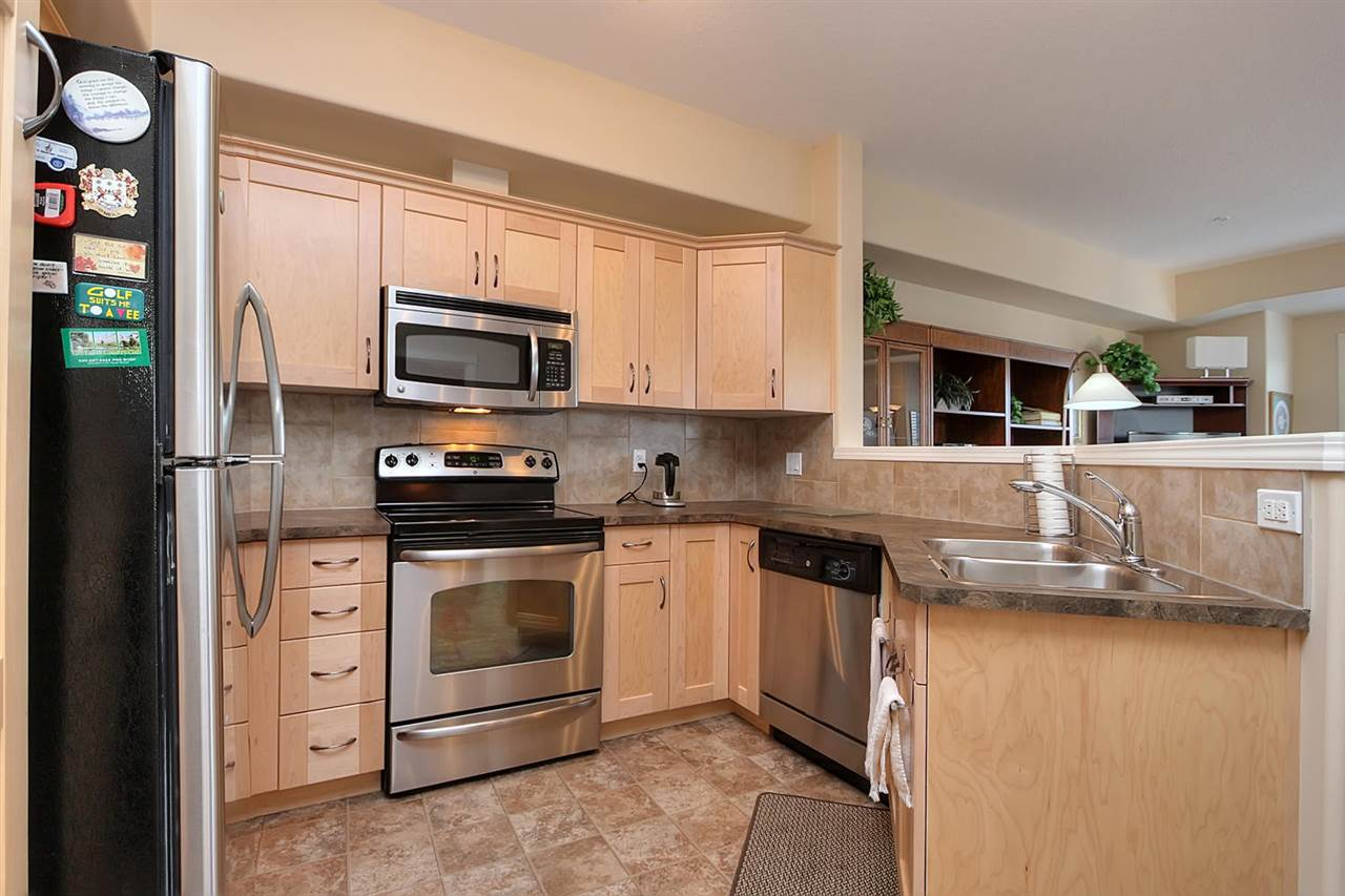 The work space is optimized in this kitchen layout. All the stainless steel appliances are in great condition.