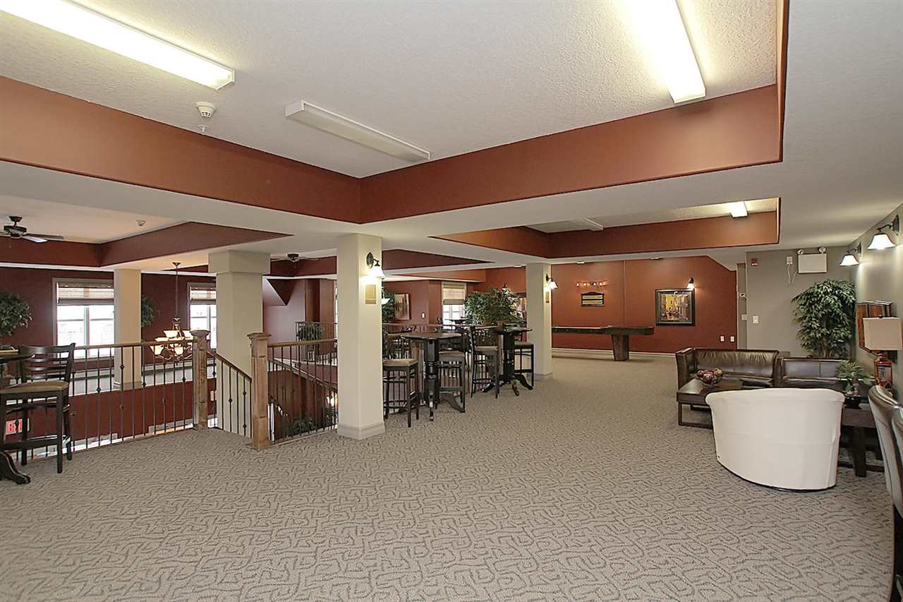 The large social area at the top of the stairwell is very well equipped with pool table, shuffleboard, poker table, small coffee bar area and seating.