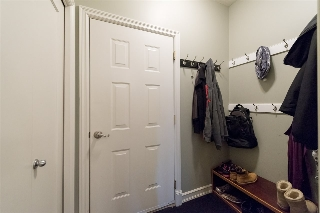 Mudroom leads to the oversized garage...