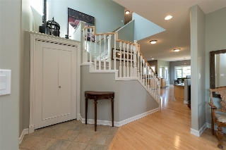 Foyer welcomes you in with vaulted ceilings...