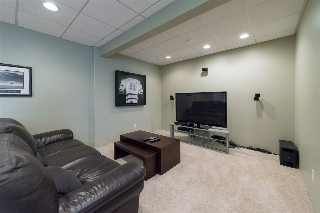 Family room featuring Bose sound system with five speakers...