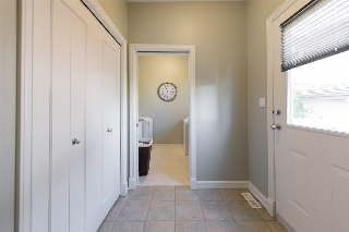 Back door landing, with an exterior door leading to the side yard...perfect for pets...
