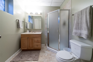 Lower level features a 3-piece bath and a bedroom...