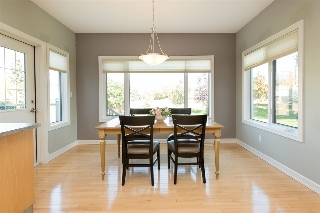 Beautiful, bright kitchen nook with large windows...