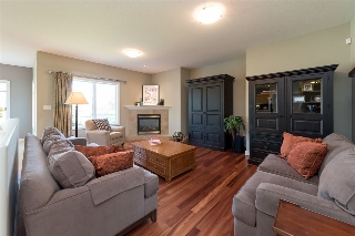 Large and comfortable great room with hardwood flooring...