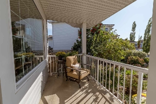 Wide front porch with room for patio furniture...