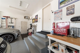 Garage is insulated & drywalled, heated, with sink, floor drain, workbench, shelving, etc...