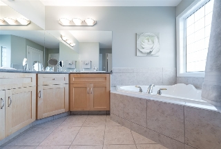 Master bath is spacious with water closet and dual sinks...