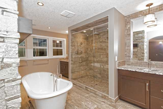 Dual sinks, heated floors, tiled back splash, over sized shower with six sprays and rain shower fixture.