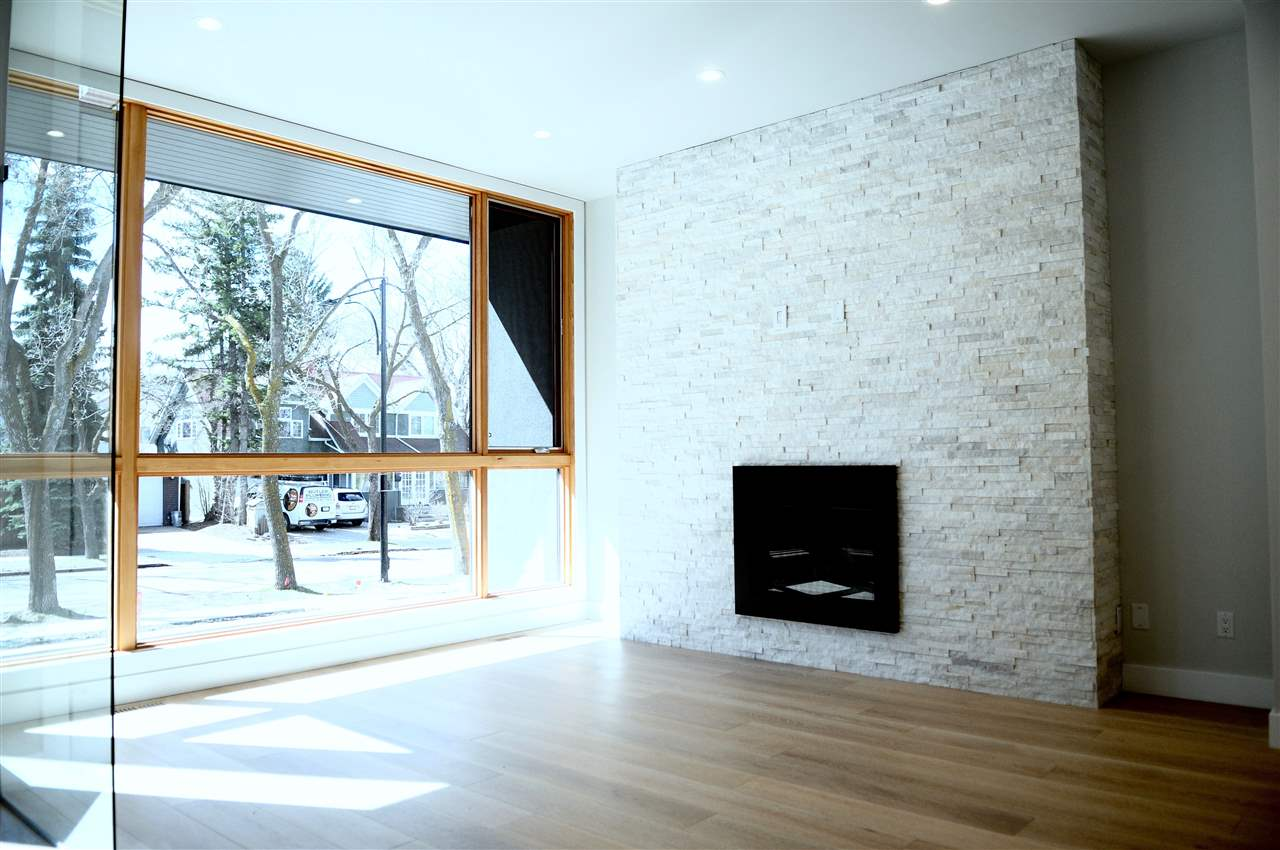 Stone faced gas fireplace with impressive triple paned windows for maximum lighting...you won't find many front room like this!!