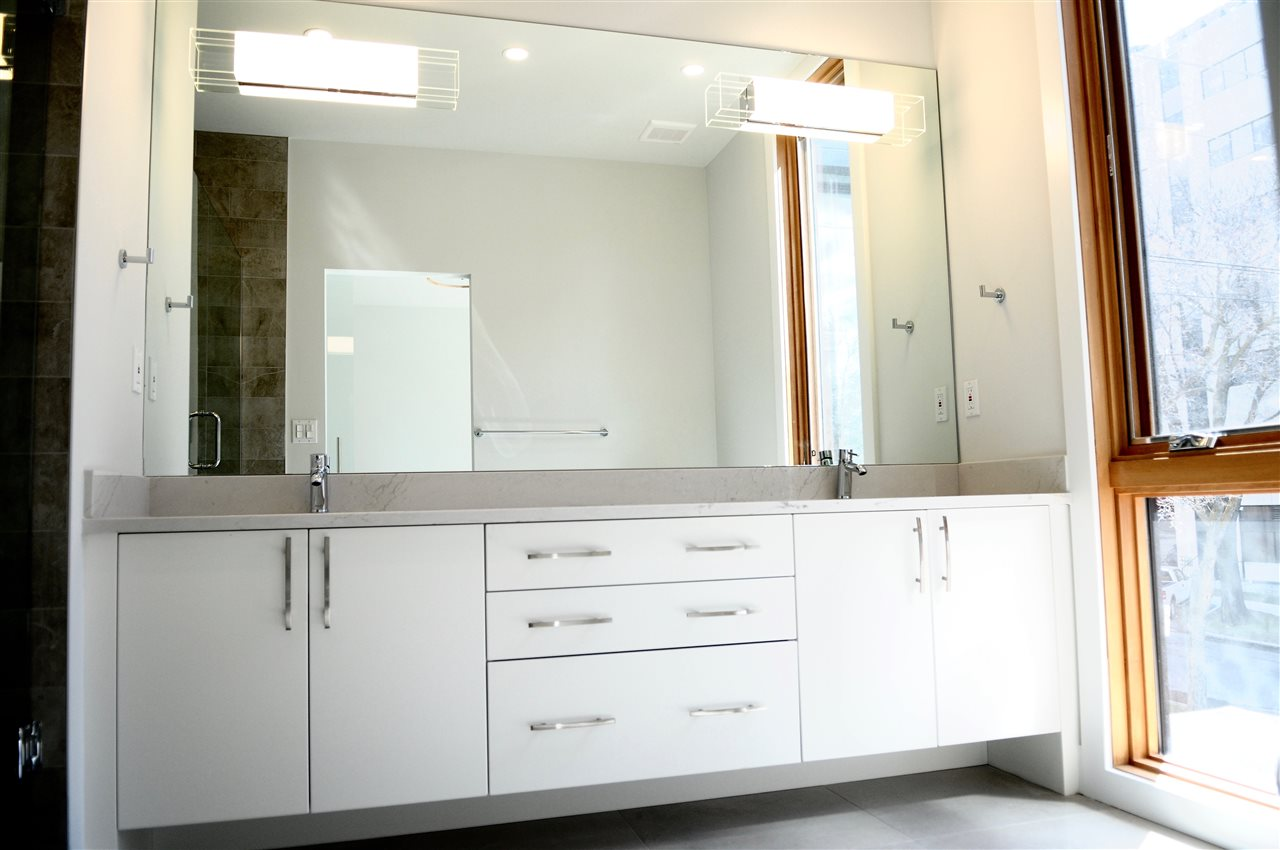 Master bath with huge walk in shower, double vanity and more..
