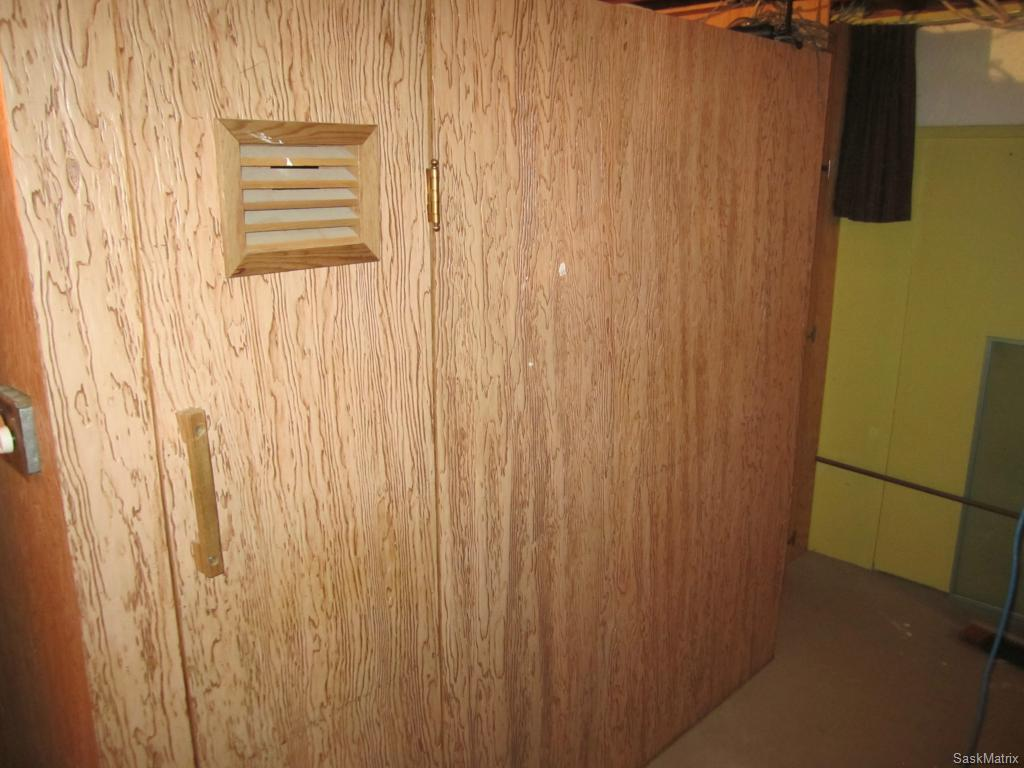 Dry sauna in basement utility room.