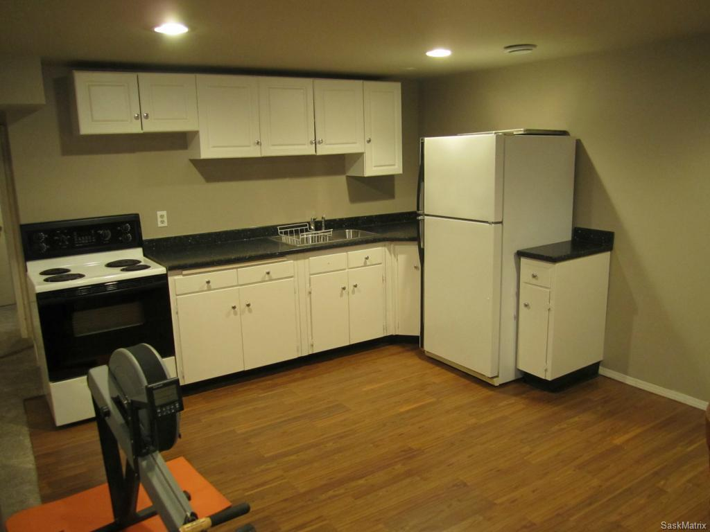 Basement suite kitchen.  Could function as wet bar for single family use.