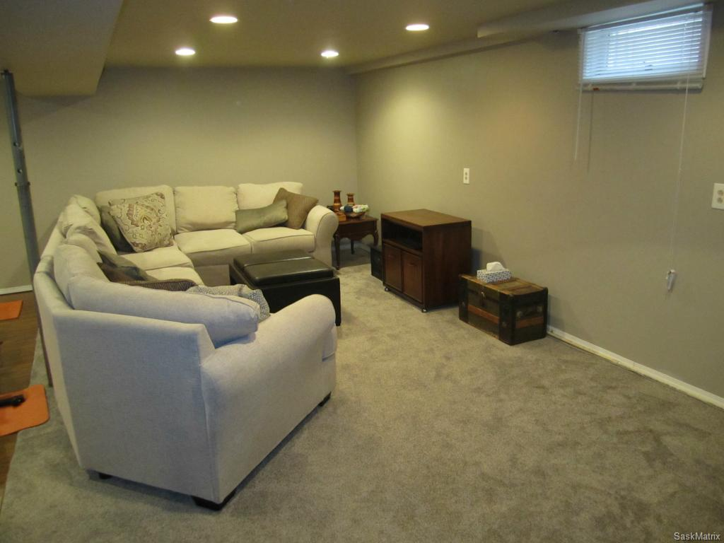 Basement living room with newer carpet.