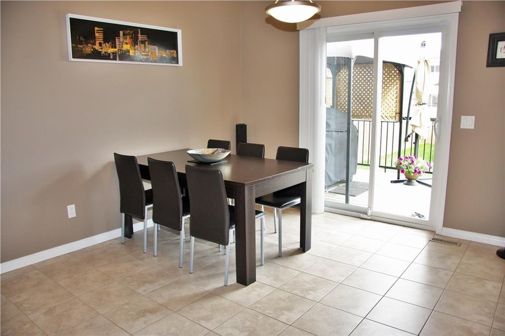 Dining area with tiled floor and doors opening onto the deck.....great for entertaining!