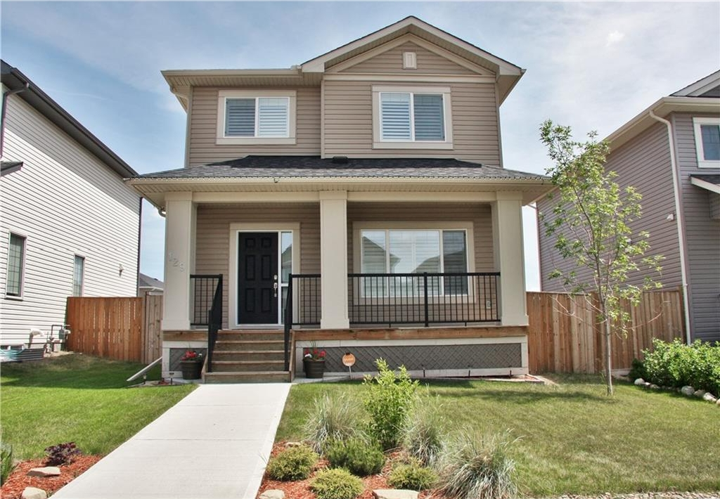 Fabulous covered front deck on this beautiful 4 bedroom home with double detached garage.