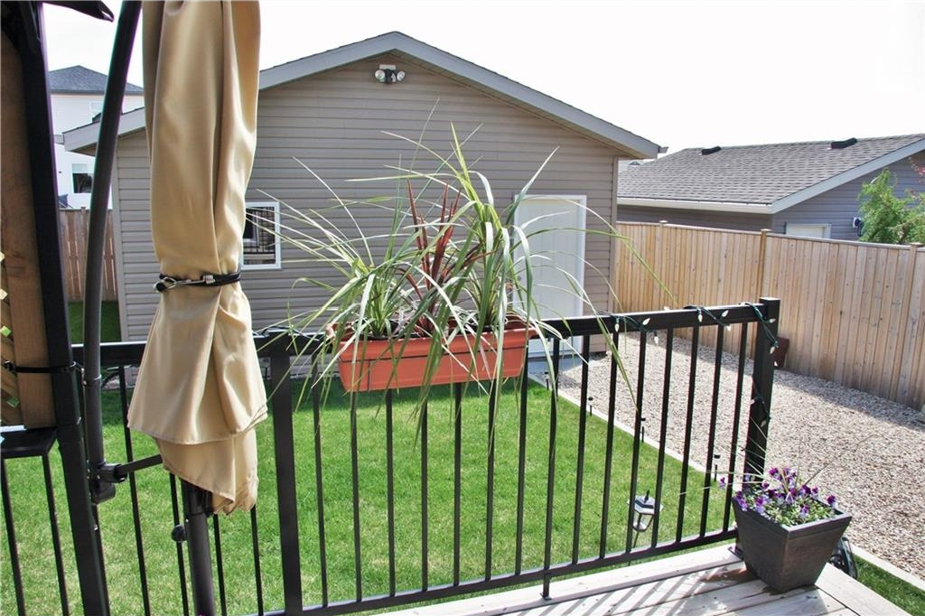 Double detached garage, great deck, landscaped and fenced backyard.....just move in and relax!