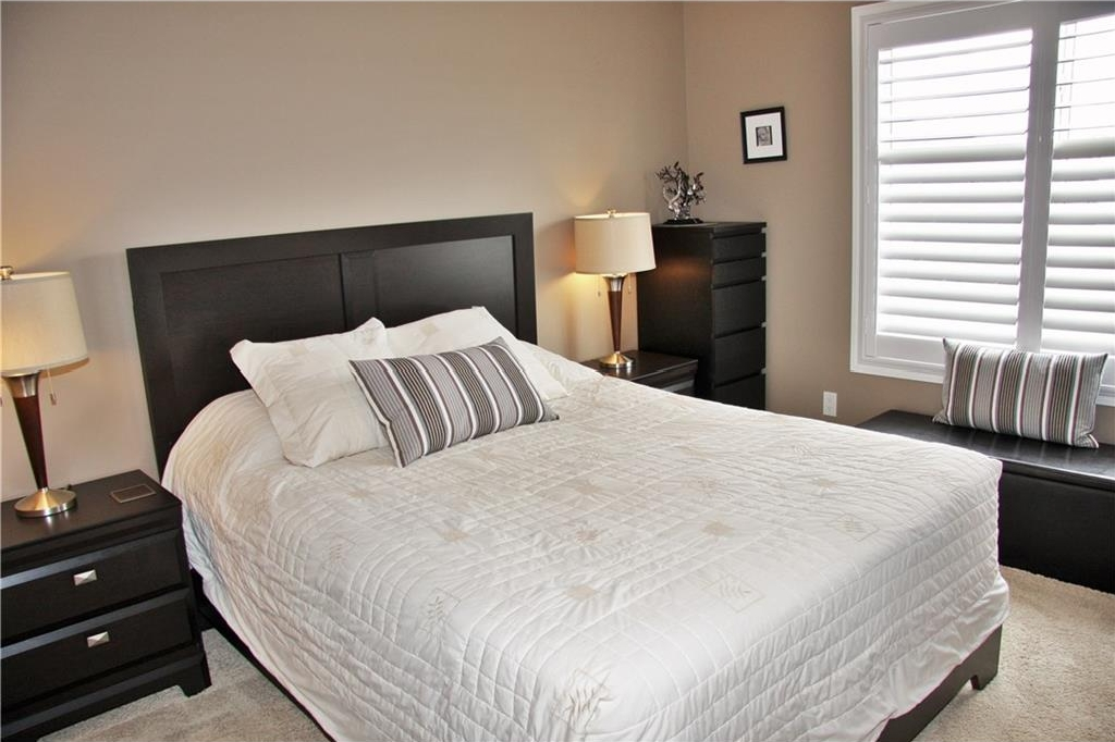 Spacious master bedroom....check out those plantation shutters!