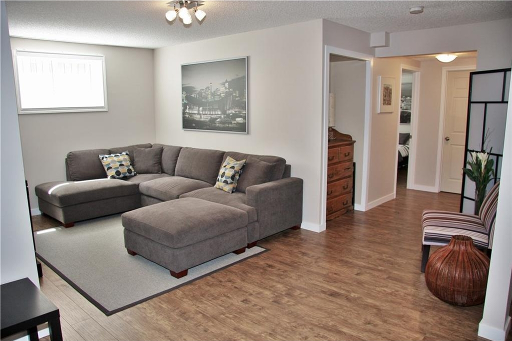 Fully finished basement with laminate flooring - great family room!
