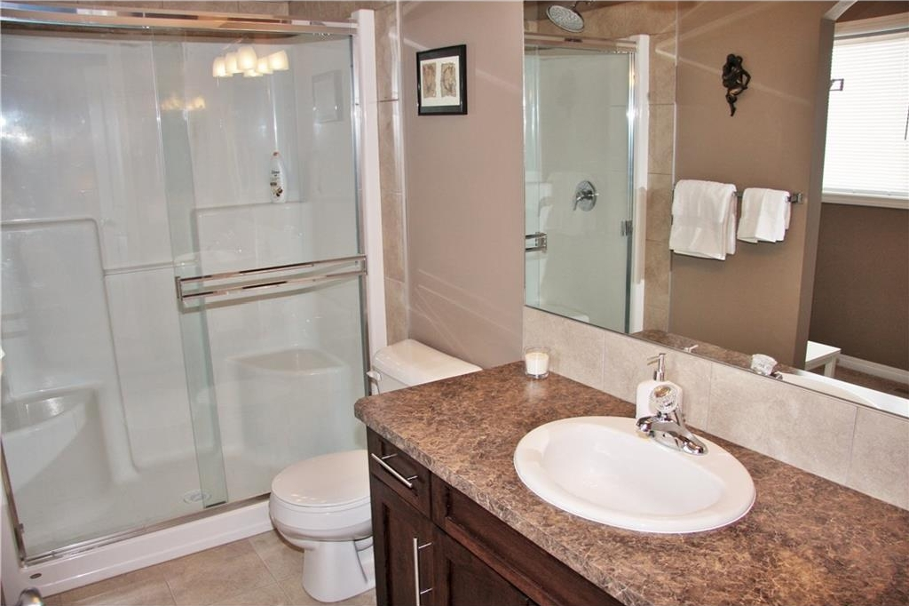 Ensuite features this huge shower, tiled flooring & large vanity