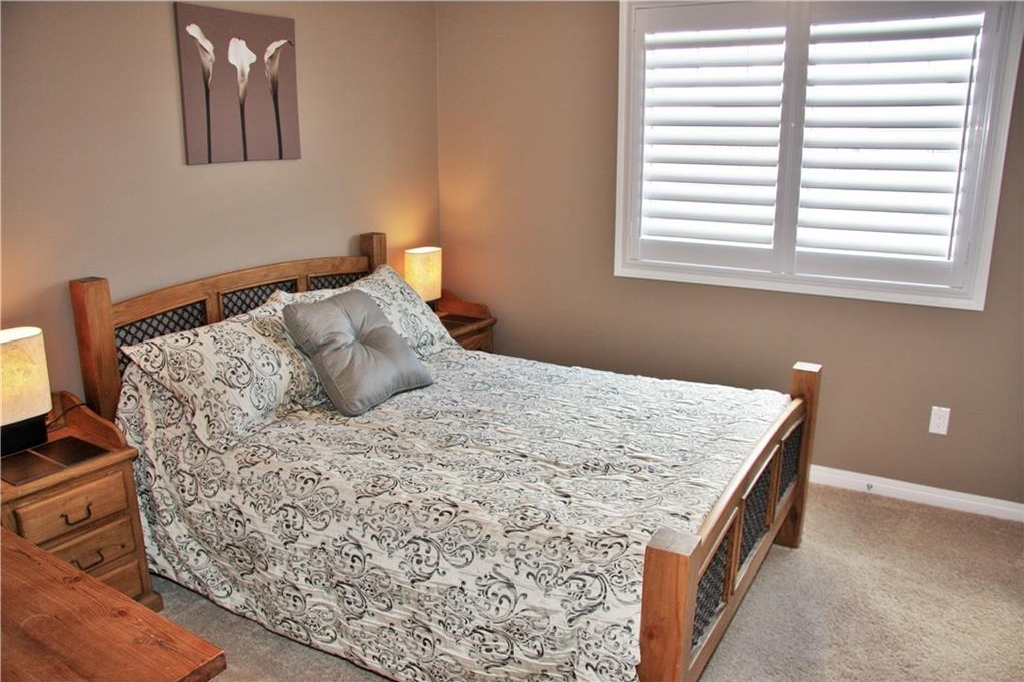 All 4 bedrooms in this home are a decent size.....check out the beautiful plantation shutters!