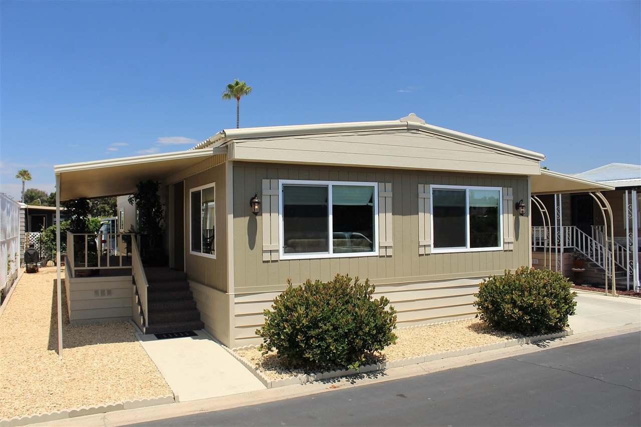 Main Photo: CARLSBAD WEST Manufactured Home for sale : 2 bedrooms : 7110 San Luis #129 in Carlsbad