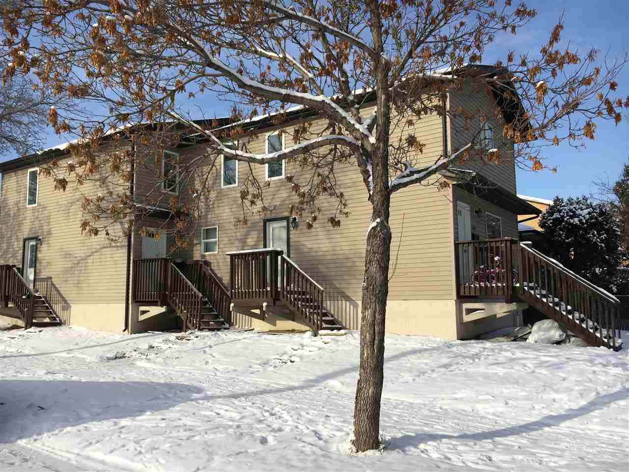 Exterior Front/Side of this Impressive Two Storey Side by Side Duplex located on a Corner Lot.