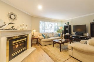 "Main Photo: 1209 PLATEAU Drive in North Vancouver: Pemberton Heights Townhouse for sale in ""PLATEAU VILLAGE"" : MLS® # R2229758"