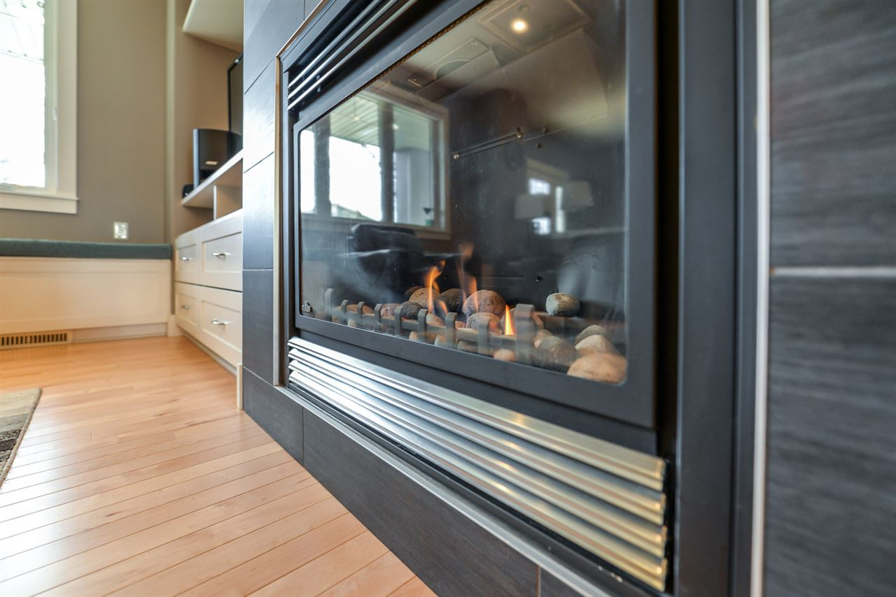 Cozy natural gas fireplace with fan