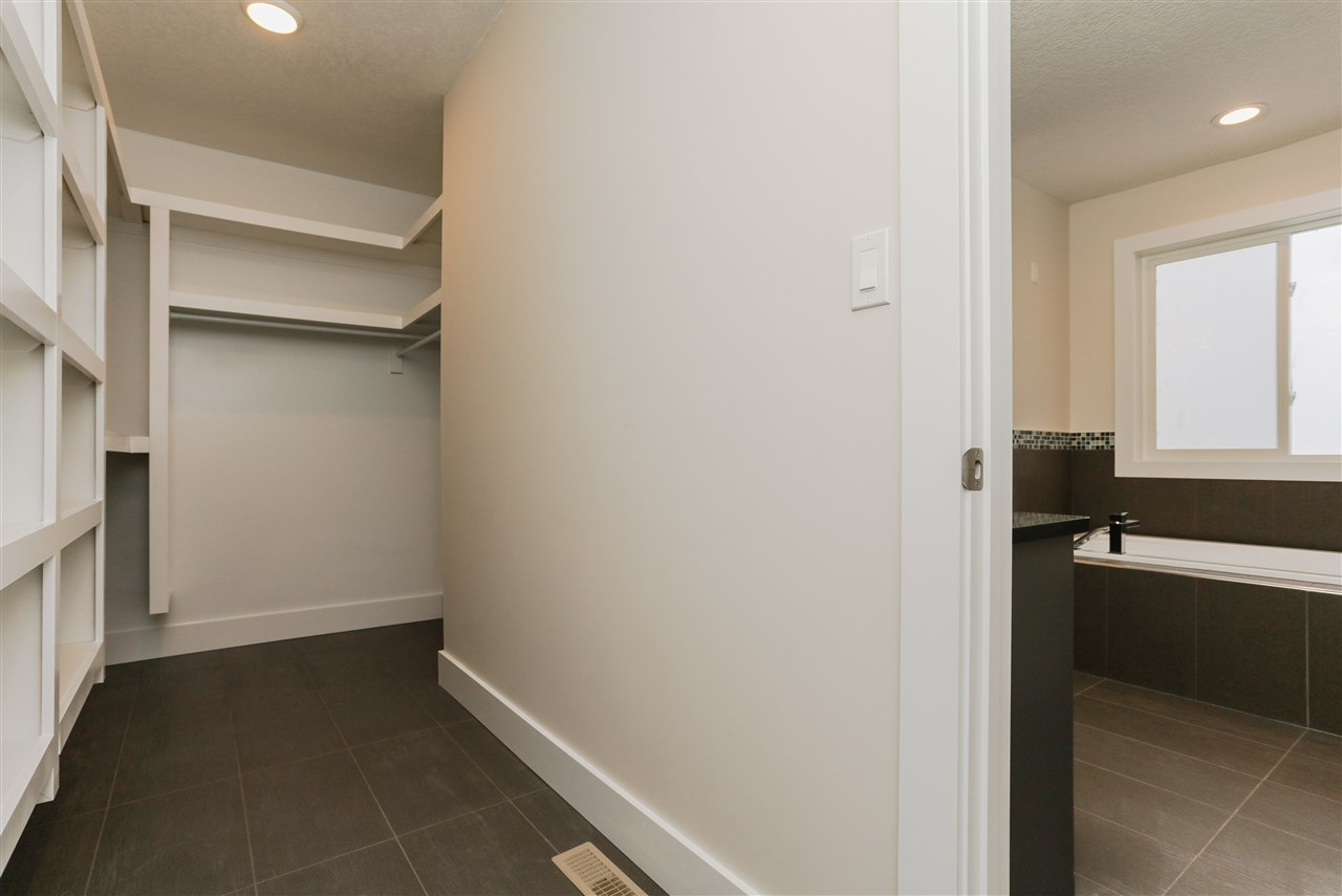 Huge walk in closet in Master with built in organisers/shelving
