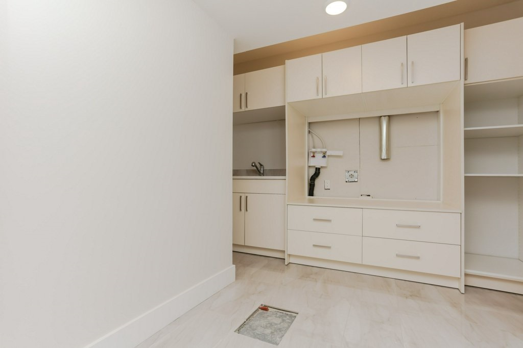 Big Laundry room with Built in Pedestals for comfort and Lots of storage with upgraded cabinets.