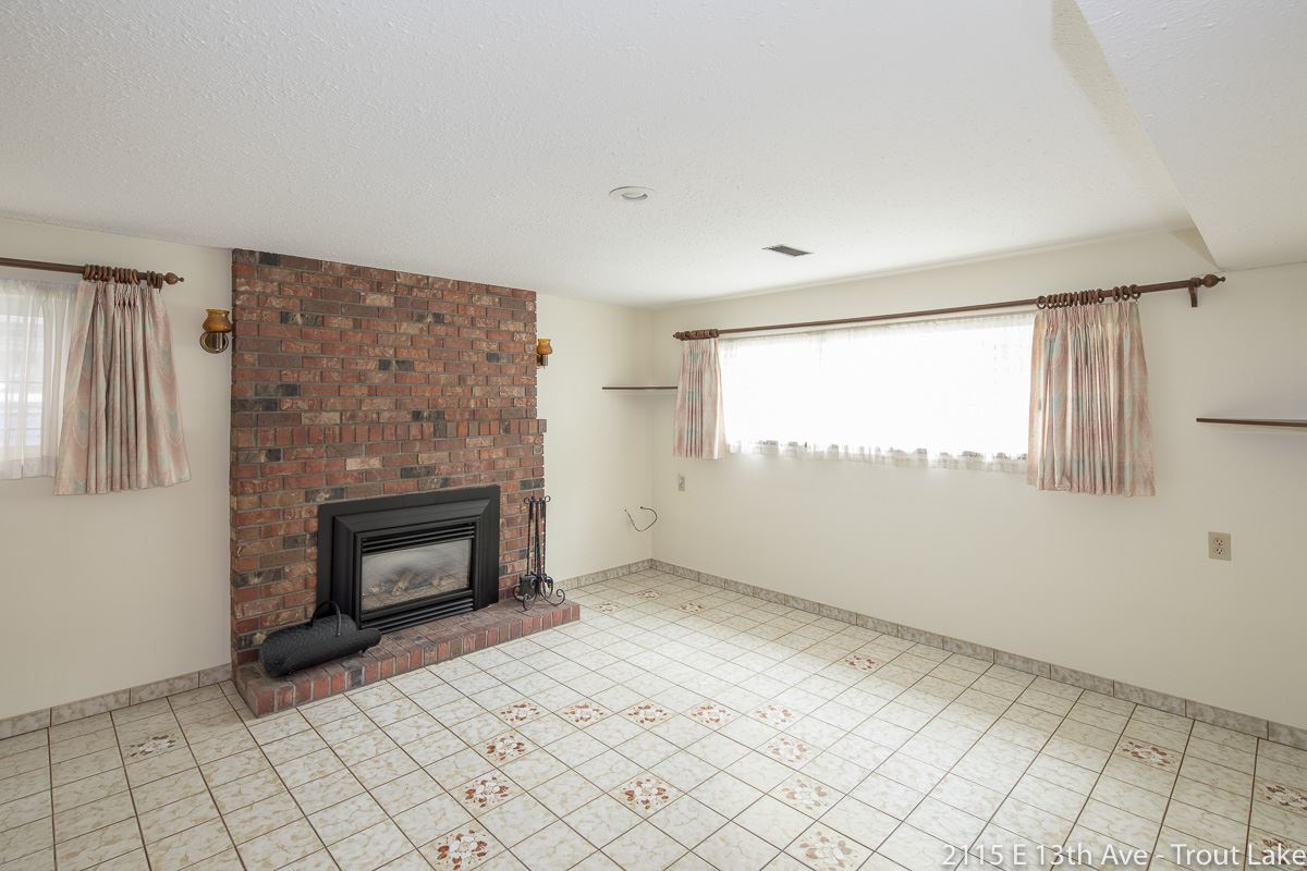 The large rec room down features a Valor Gas Fireplace insert.