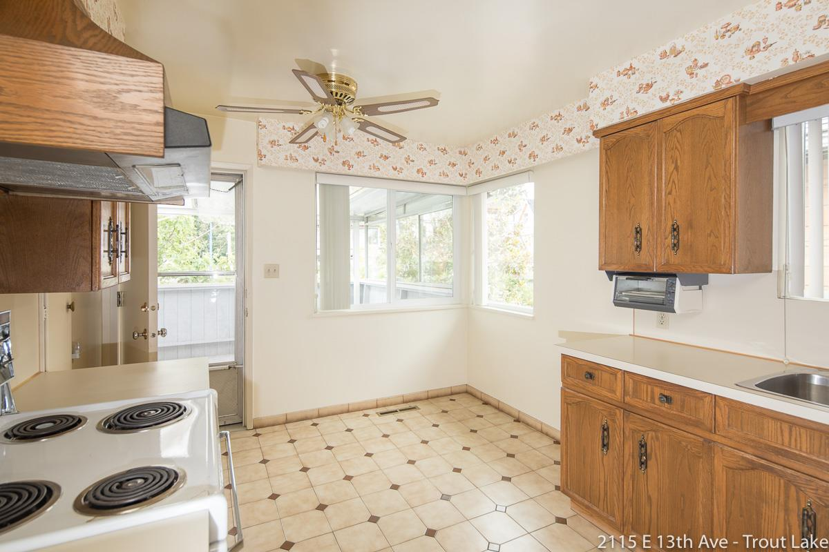 The Kitchen has access to the covered back patio.  Great for your BBQ or a sit down meal.  There are stairs down into the back yard and easy access to the garage as well.