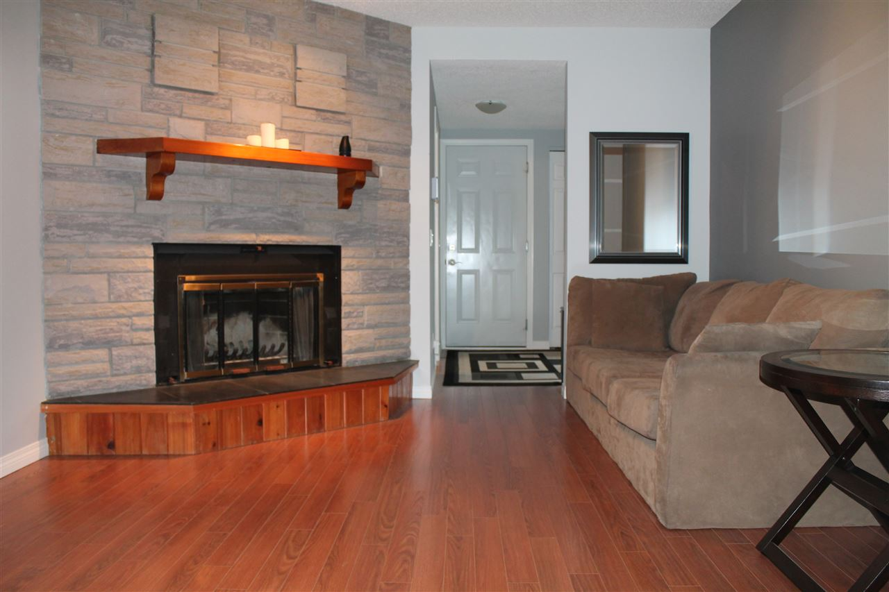 Family Room With Laminate Flooring & Wood-Burning Fireplace For Your Enjoyment On Those Cold Winter Nights