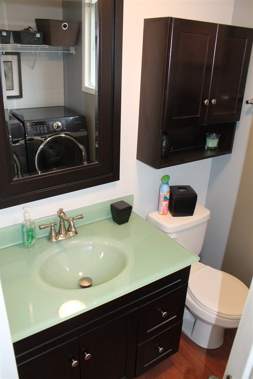 2 Piece Bathroom On The Main Floor Which Also Serves As Your Laundry Area With Samsung Washer And Dryer