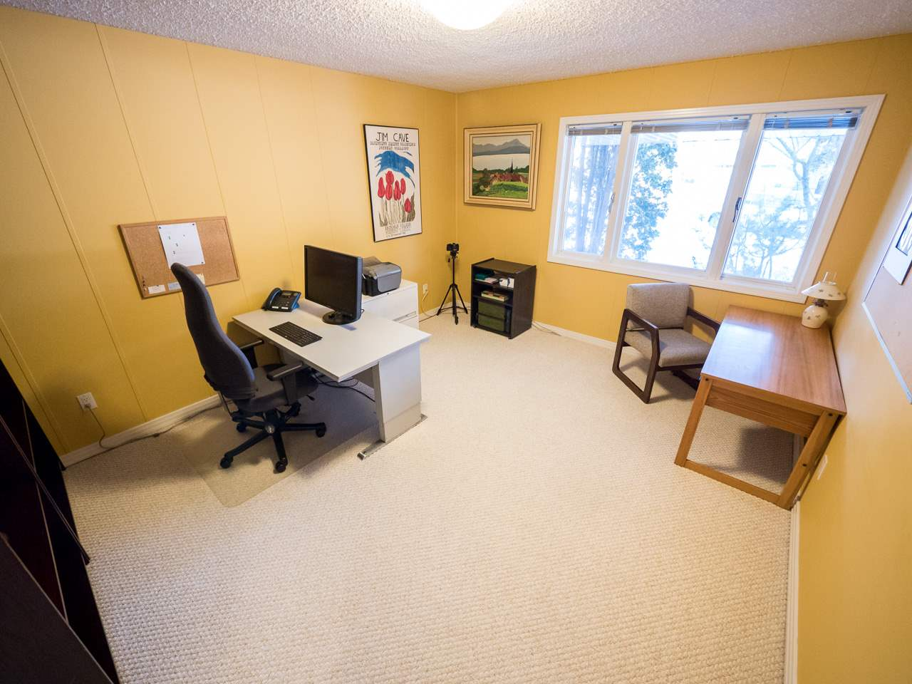 Just off the hallway at the front of the house. This Office is big enough for 3 desks easy.
