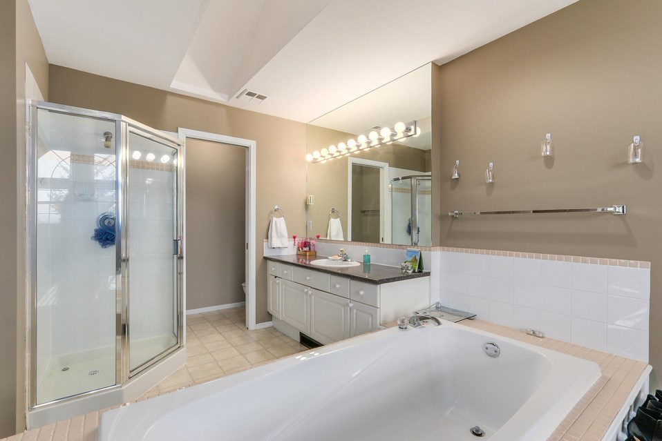Open bathroom in the Master Bedroom with enclosed space for the toilet