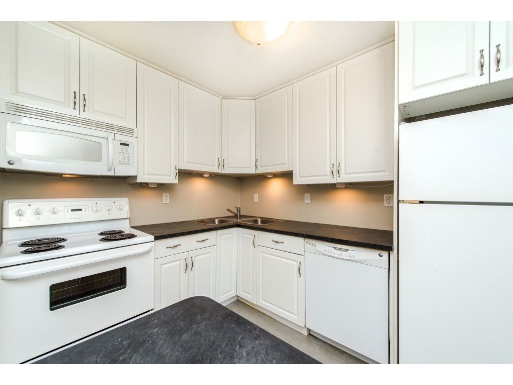 "Photo 1: Photos: 211 32870 GEORGE FERGUSON Way in Abbotsford: Central Abbotsford Condo for sale in ""Abbotsford Place"" : MLS® # R2212123"