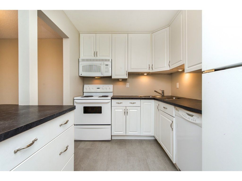 "Photo 2: Photos: 211 32870 GEORGE FERGUSON Way in Abbotsford: Central Abbotsford Condo for sale in ""Abbotsford Place"" : MLS® # R2212123"