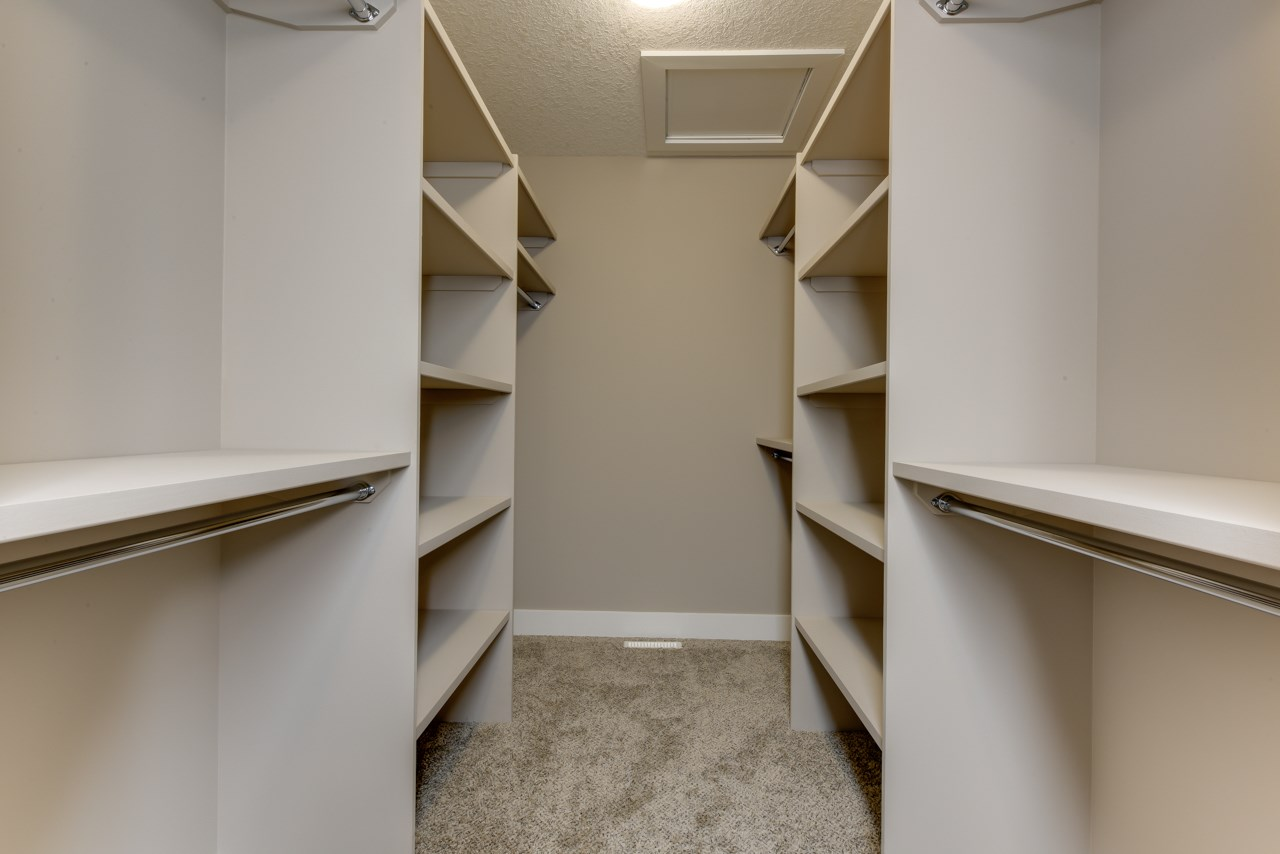 Large walk-in closet with tons of built-ins