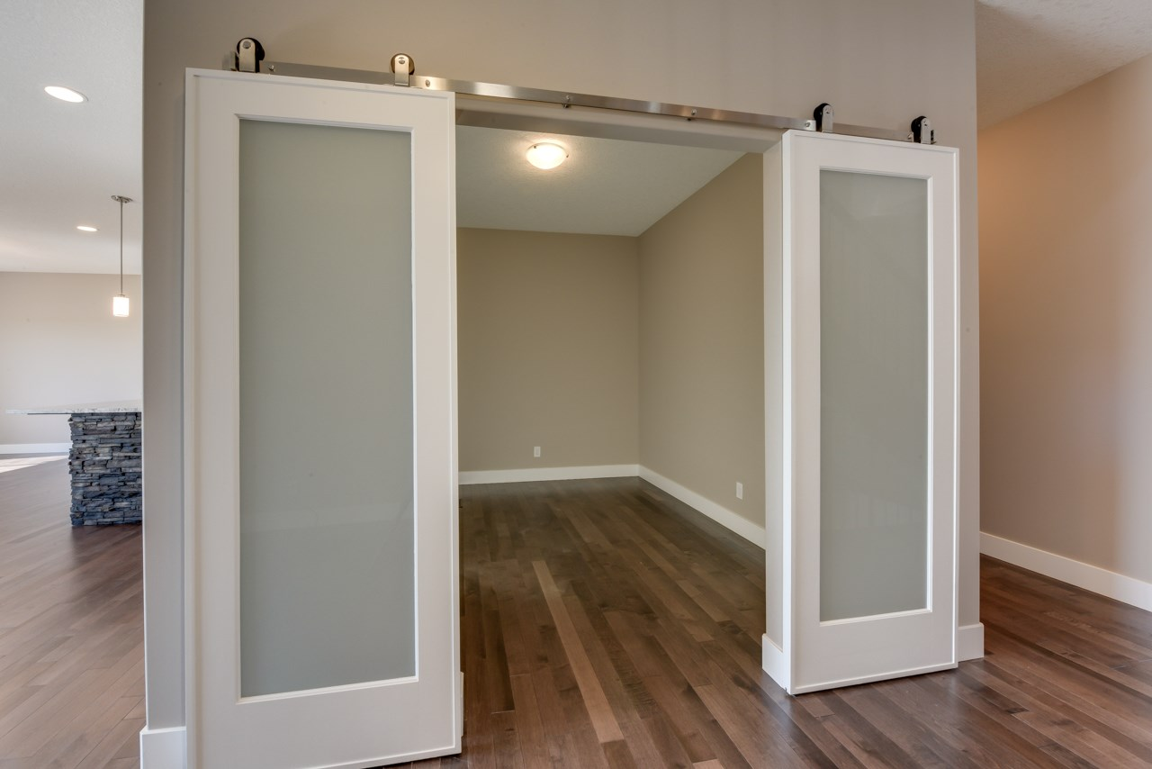 Main floor office or den with sliding barn doors