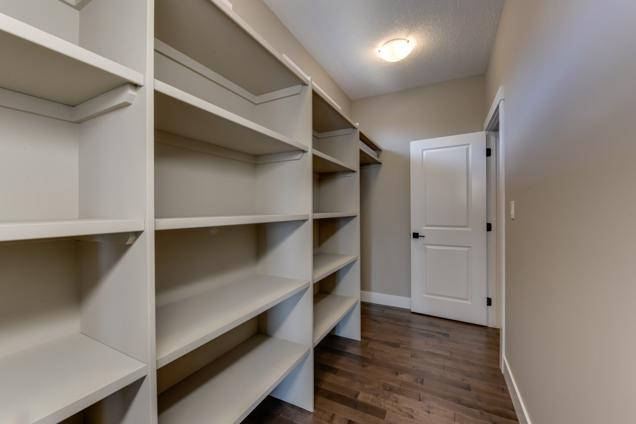 Huge walk-thru pantry with space for 2nd fridge or freezer