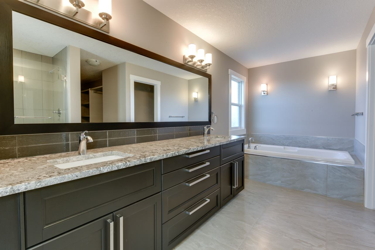Double sinks with granite countertops