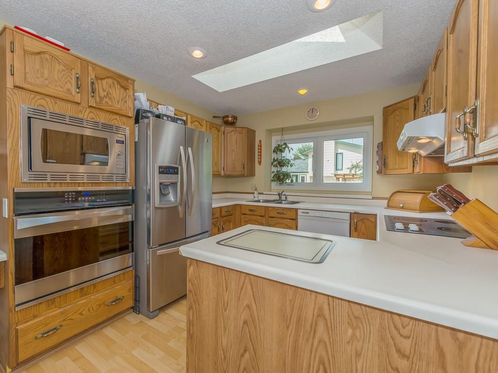 Kitchen with built-in stainless steel appliances.
