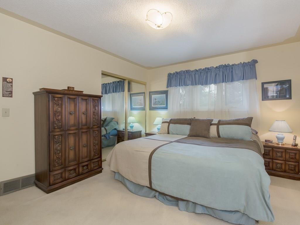 Spacious master bedroom located on upper level.