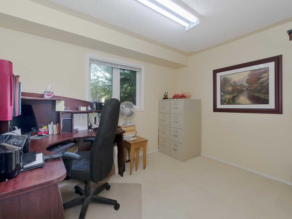 Main floor flex room can be used as an office or a bedroom.