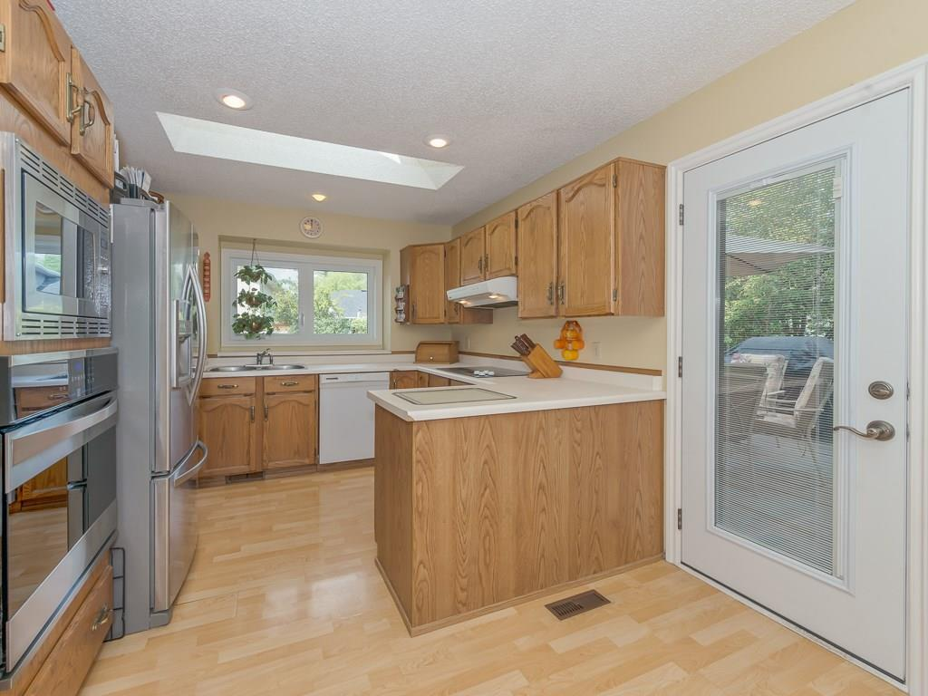 Kitchen with patio door leading to rear deck.