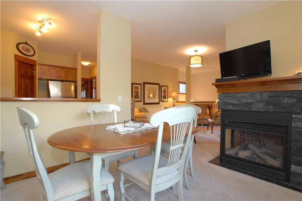 Upper Level Dining & 2 Sided Fireplace