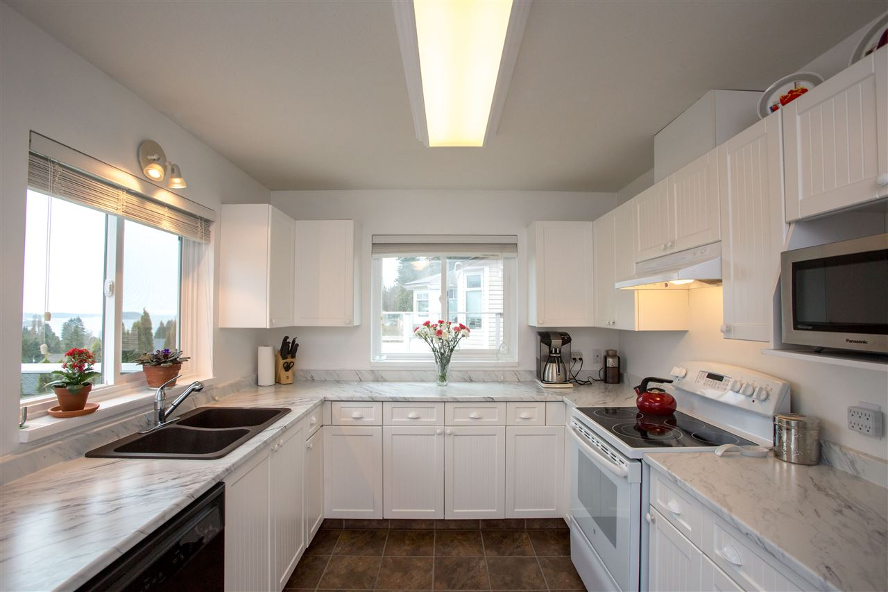 Beautiful bright kitchen opening onto front deck: views from every window!
